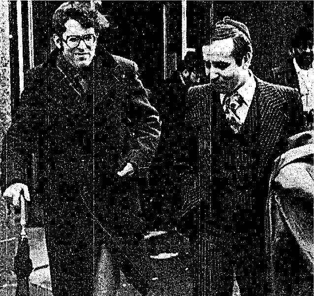 Hirsch, right, and aide Matthew Abraham after booking, 1-8-1979