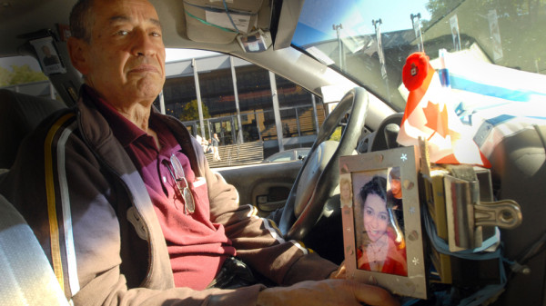 Cabbie with family picture, etc