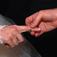 Wedding ring placed on finger