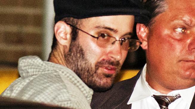Levi Aron closeup cops cap short peyot