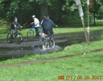 Haredi kids ride bikes in Passaic park after hurricane when police want people to remain inside 8-28-11.jp