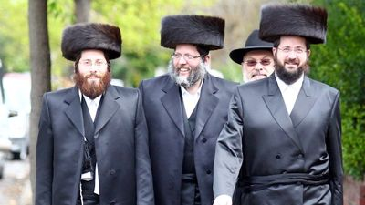 From left, Chaim Friedman, Benyomin Friedman, Imi Weinstein and Moshe Friedman walk from their local synagogue in Ripponlea in Melbourne. Picture- Aaron Francis Source- The Australian