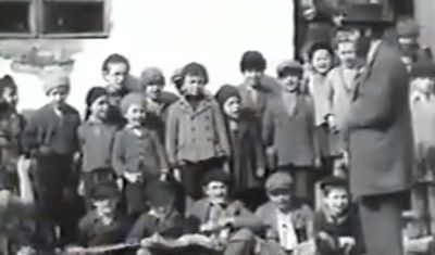 Cheder teacher and his studetnts, Munkatch 1933