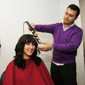 Orthodox woman getting wig styled