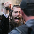 Haredi man yelling at soldier, finger point