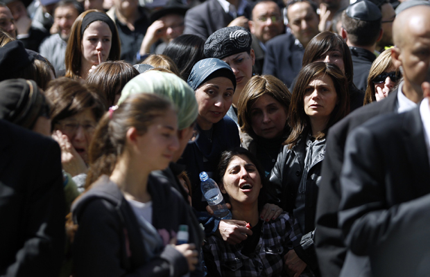 The mother of seven-year-old Miriam Monsonego (bottom C) mourns during the joint funeral service in Jerusalem for her daughter and the other three victims of Monday's shooting in Toulouse March 21, 2012 Brad Ratner Reuters