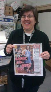 Shoshana Berrkovic (Feldman's mother) holding the NY Post cover