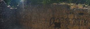 Grafitti on wall near vandalized mosaic 4-23-2012