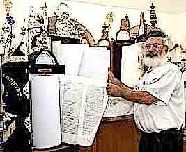 Mordechai Vaknin of Mosha Brosh poses with synagogue's Torah scrolls 2