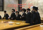 Munkatcher Rebbe dances with Spinka Gabbai and drug smuggler Yoel Zev Goldstein Hanukkah 12-12-2012 annotated