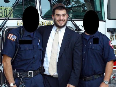 Aryeh Goodman posing with police sometime before his 1-2013 arrest