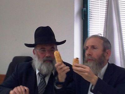 Rabbis Bar-Giora, left, and Sabag, right, examoning the shape of baked good 2-2013 Jerusalem
