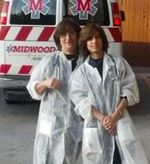 Ruchie Freier and her mother in front of an ambulance 3-2013 cropped