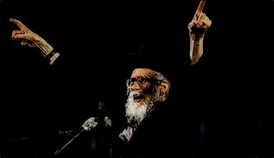 Rabbi Eliezar Berland arms up dark