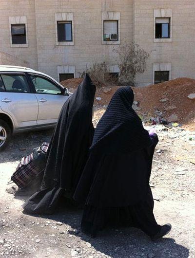 Burka Cult women, one with head tube 12-2011