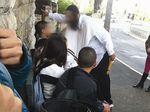 Haredi man harasses secular kids at bus stop