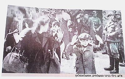 Warsaw Ghetto Roundup post uprising little boy arms up iconic censored by haredi newspaper BaKehillah 3-25-2013