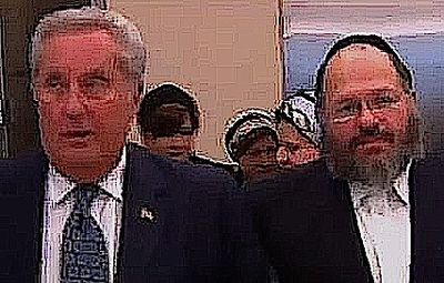 Rabbi Nechemya Weberman (right) and his attorney George Farkas (left) 2