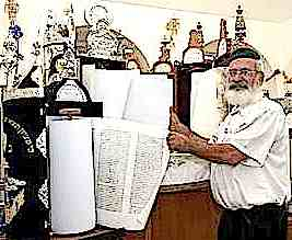 Mordechai Vaknin of Mosha Brosh poses with synagogue's Torah scrolls 2