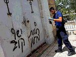 Cleaning Price tag graffiti off Jerusalem's Dormition Church 5-31-2013