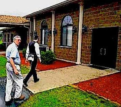 Town of Thompson, NY Supervisor Tony Cellini, left, walks toward the synagogue of Kaufman's Bungalow Colony with Mendel Lerner, 7-2013 2