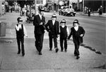 Haredi kids walking eyes covered B and W