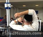 Hasid in Newark airport hogging power strip 6-25-2013