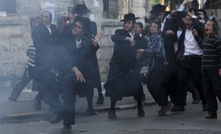Haredim throwing stones