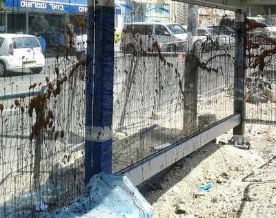 Vandalized bus stop Jerusalem Geula 7-2013