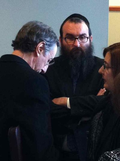 Andrea Sneiderman (right) with her attorney and Chabad Rabbi Hirsch Minkowicz