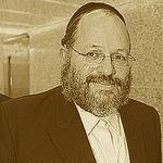 Rabbi Nechemya Weberman sepia smile