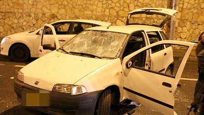Arab car stoned by haredim Jerusalem pro-Abergel protest 11-16-2013