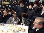 DA elect Ken Thompson at Satmar Zalmanite celebration of Rebbe's rescue from Nazis talking to Rabbi David Niederman 11-23-2013