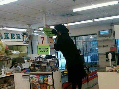"Vaad Hatznius hanging up a ""men only"" signs making segregated checkout aisles in Kiryas Joel supermarket 2-16-2014"