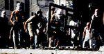 Masked Palestinians throwing stones