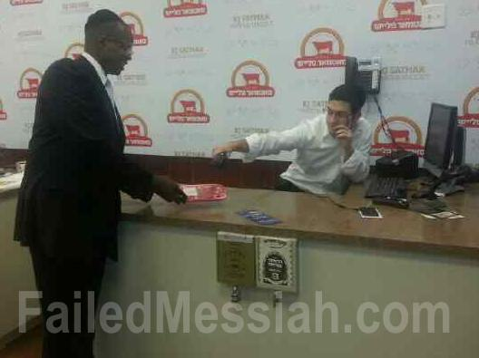 DA Ken Thompson buying meat at new hasidic butcher shop in Williamsburg 2-20-2014