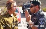 Ariel Zilber, left, and a Border Police commander 9-2014