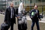 Rabbi Eliezer Berland on way to court in Haarlem, Netherlands 11-17-2014 tallis tefillin