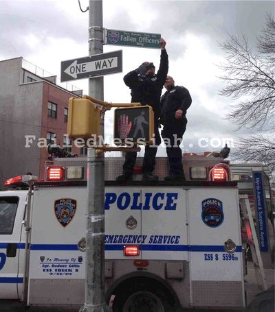Fallen Officers Way Street sign being put up in Brooklyn 1-19-2015 watermarked color corrected