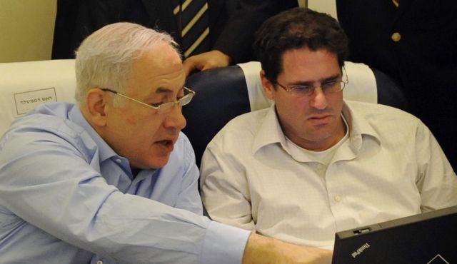 Benjamin Netanyahu, left, Ron Dermer, right