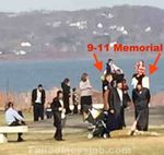 Hasidim with boys sitting on 9-11 memorial in Haverstraw watermarked 4-2015
