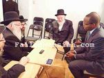 "Brooklyn DA Ken Thompson visiting Moshe ""Gabbi"" Friedman during shiva 12-2014 watermarked"