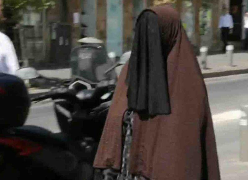 Ariella Sternbach posing as a haredi Taliban cult woman Jerusalem 9-2015
