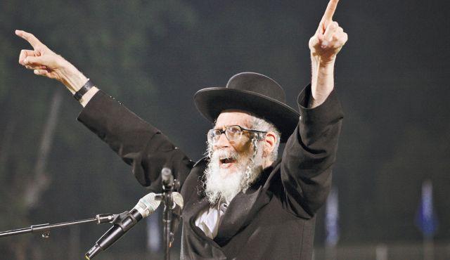 Rabbi Eliezar Berland arms up