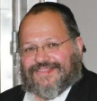 Rabbi Nechemya Weberman closeup smile