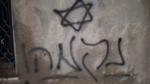 Douma arson graffiti %22revenge'