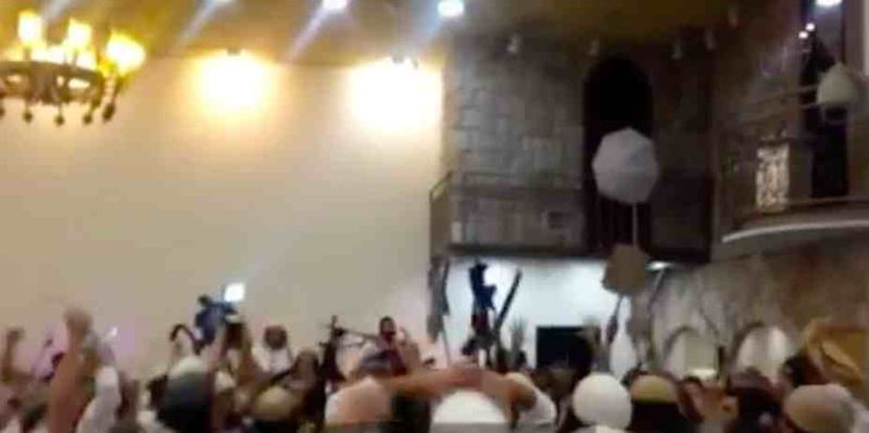 Settlers wave machine guns, knives in celebration of arson-murder of 18-year-old Palestinian baby and his parents in Douma (Duma) in July 2015 (video released on 12-23-2015)