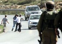 Settlers attacking AFP photographer Abbas Momani in Beit El, March 2014