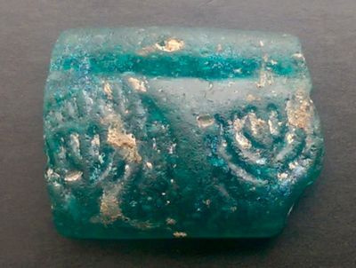 Turquoise glass bracelet fragment with 2 menorahs dated to circa 500 CE (IAA 12-2014) large