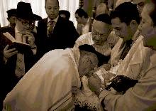 A. Romi Cohn Doing Metzitzah B'peh Brooklyn 9-2012 3
